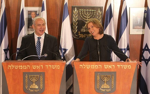 Prime Minister Benjamin Netanyahu and Hatnua party leader Tzipi Livni at the joint press conference where Livni announced she was joining Netanyahu's government as minister of justice, February 19, 2013. (Photo credit: Miriam Alster/FLASH90)