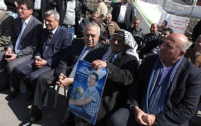 Former Palestinian prime minister Salam Fayyad participates in a sit-in tent in support of Palestinian prisoners on hunger strike in Israeli prisons, in the West Bank city of Ramallah on February 20, 2013 (photo credit: Issam Rimawi/Flash90)