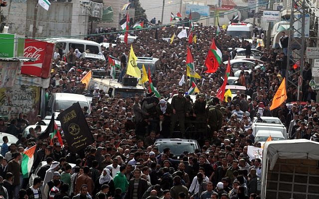 Thousands of Palestinians attend the funeral of Arafat Jaradat in the West Bank village of Si'ir, near Hebron on Monday, February 25 (photo credit: Issam Rimawi/Flash90)