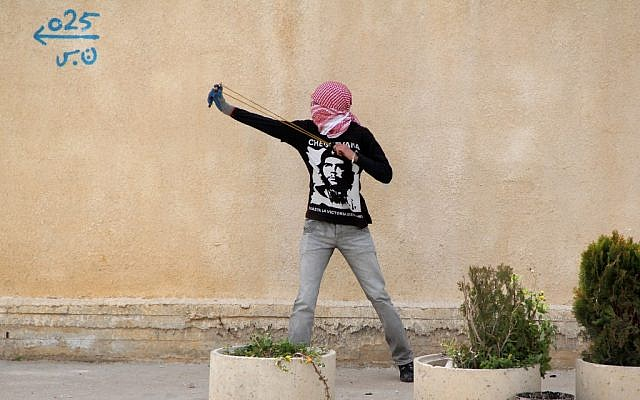 A protester slinging stones near Ramallah Monday. (photo credit:  Issam Rimawi/Flash90)