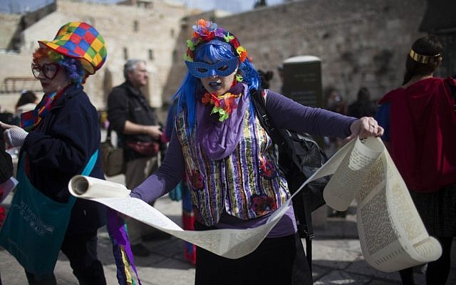 Members of the activist group Women of the Wall celebrate the holiday of Purim with a reading of the Scroll of Esther at the Western Wall, Judaism's holiest site, in Jerusalem on February 23, 2013. (photo credit: Yonatan Sindel/Flash90)