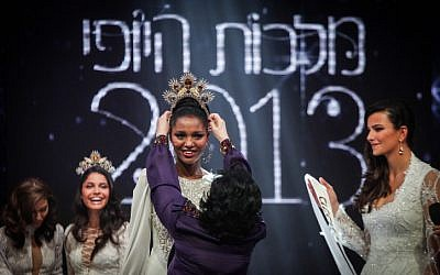 Yityish Aynaw, who immigrated to Israel at age 12 from Ethiopia, is crowned Israel's beauty queen on Wednesday, Feb. 27 (photo credit: Avishag Shar Yashuv/Flash90)