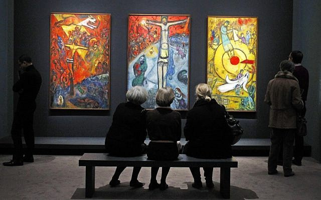"A triptych by Russian artist Marc Chagall at the exhibition: ""Chagall, between War and Peace"" at the Luxembourg museum in Paris. Paintings are from left: Resistance (1937), Resurrection (1948), and Liberation (1952). (photo credit: Remy de la Mauviniere/AP)"