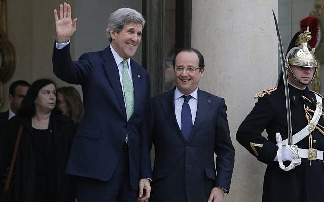 US Secretary of State John Kerry, left, is accompanied by France's President Francois Hollande after their meeting at the Elysee Palace, in Paris, on Wednesday, February 27, 2013. (photo credit: AP Photo/Francois Mori)