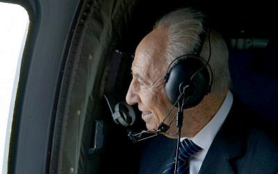 President Shimon Peres looks out of a helicopter window at a large portrait of himself etched in a field, February 2013. (photo credit: Mark Neeman)