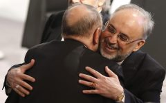 Iranian Foreign Minister Ali Akbar Salehi, right, hugs former NATO Secretary General Javier Solana as he arrives for the Security Conference in Munich, Germany, on Sunday, Feb. 3, 2013. (photo credit: AP/Matthias Schrader)