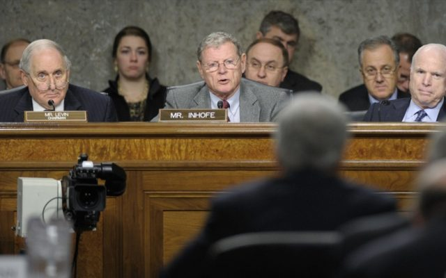 Senate Armed Services Committee ranking member Sen. James Inhofe, R-Okla., center , asks a question of former Nebraska Sen. Chuck Hagel, in foreground, during the Senate Armed Services Committee hearing on his nomination on Thursday. Senate Armed Services Committee Chairman Carl Levin, D-Mich., left, and Sen. John McCain, R-Ariz., right, listen. (photo credit: AP/Susan Walsh)