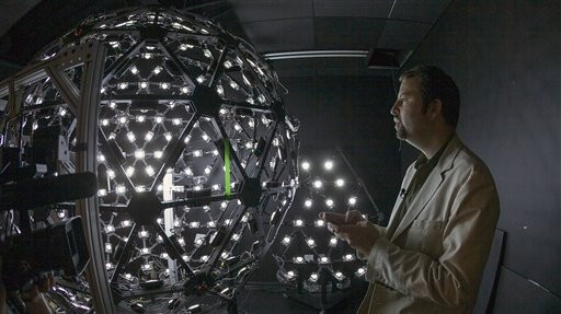 Paul Debevec, the associate director for graphics research at the University of Southern California's Institute for Creative Technologies, explains the Lighting Stage X, an LED-filled sphere used to help create realistic virtual characters, in Los Angeles on Tuesday (photo credit: AP/Damian Dovarganes)