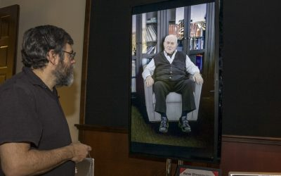 Computer scientist David Traum interacts with the digital doppelganger of Holocaust survivor Pinchus Gutter at the University of Southern California in Los Angeles on Tuesday (photo credit: AP/Damian Dovarganes)