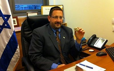 The rabbi and the rock: Dov Lipman in his Knesset office (photo credit: Courtesy)