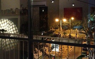 The shifting urban landscape from the balcony window (photo credit: Jessica Steinberg/Times of Israel)