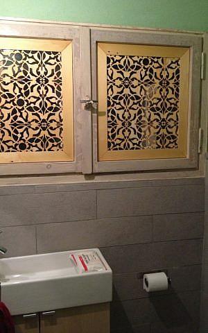 The guest bath's masharabiya screened window (photo credit: Jessica Steinberg/Times of Israel)
