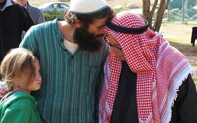 Nachum Pachenik (left) at a soccer game with Palestinians (photo credit: courtesy/Nachum Pachenik)
