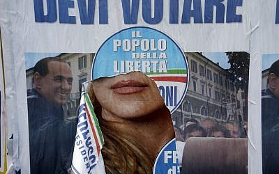 A torn electoral poster shows center-right coalition leader Silvio Berlusconi in Rome, Monday, Feb. 25, 2013. Italy's crucial elections appear to be heading toward gridlock, initial results show, with the center-left forces of Pier Luigi Bersani headed toward victory in the lower house of Parliament and the camp of former premier Silvio Berlusconi gaining the upper hand in the equally powerful Senate. (photo credit: AP/Gregorio Borgia)
