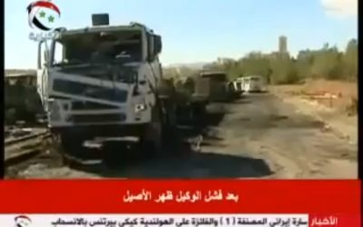 A burnt out truck seen in a video from Syrian state TV purporting to show damage caused by an Israeli strike on a research facility. (via YouTube)