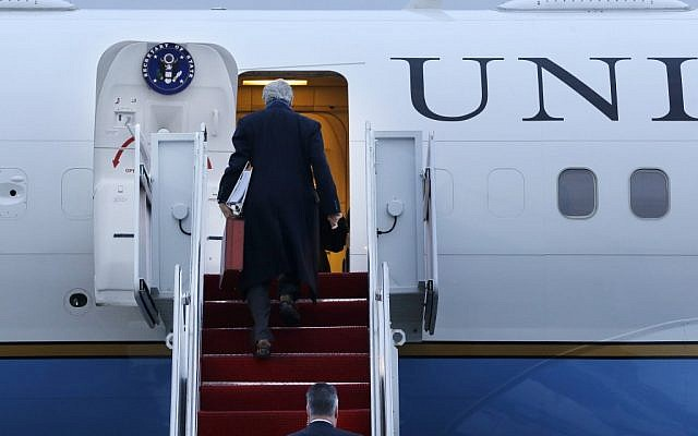 John Kerry boarding his plane at Andrews Air Force Base, MD., en route to London in his inaugural official trip as secretary of state on Sunday. (photo credit: AP/Pool, Jacquelyn Martin)
