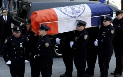 A casket containing the remains of former New York City Mayor Ed Koch is brought into Temple Emanu-El, for his funeral in New York on Monday. (photo credit: AP/Seth Wenig)