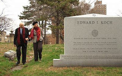 The former New York mayor visits his own gravestone in the documentary 'Koch.' (Courtesy Zeitgeist Films)