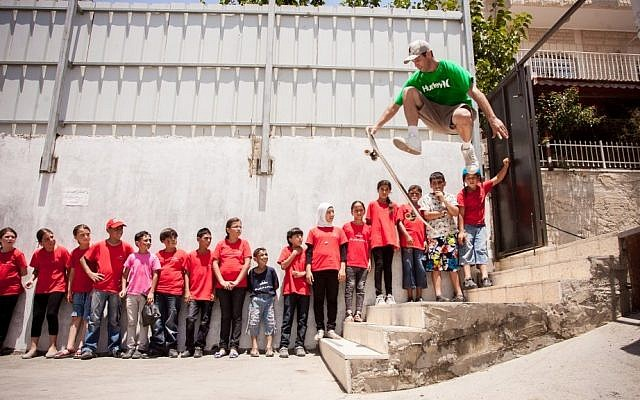 Yoni Ettinger dazzles a mixed Israeli and Palestinian group with his longboarding tricks (photo credit: Yair Hasidof)