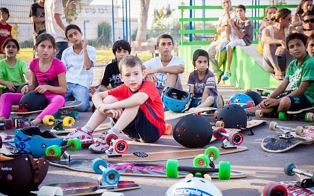 Taking a break from longboarding in Sderot (photo credit: Yair Hasidof)