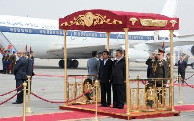 Mohammed Morsi, right, and Mahmoud Ahmainejad at Cairo airport on Tuesday. (photo credit: AP/Egyptian presidency)