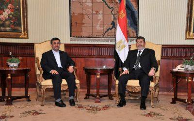 Iranian President Mahmoud Ahmadinejad, left, and Egyptian President Mohammed Morsi, in Cairo, Egypt, Tuesday, Feb. 5, 2013. (photo credit:AP/Egyptian)