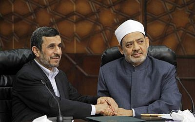 Iran's President Mahmoud Ahmadinejad meets with Grand Sheik Ahmed el-Tayeb, the head of Al-Azhar, the Sunni Muslim world's premier Islamic institution on Tuesday, Feb. 5, 2013 (photo credit: AP/Amr Nabil)