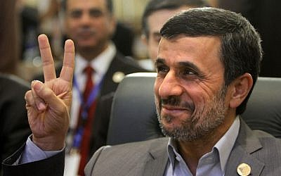 Iran's President Mahmoud Ahmadinejad flashes the victory sign as he attends the 12th summit of the Organization of Islamic Cooperation in Cairo, Egypt, Wednesday, Feb. 6 (Photo credit: AP/Amr Nabil)