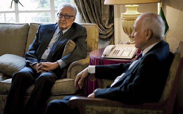 Arab League Secretary-General Nabil Elaraby, right, meets with U.N.-Arab League envoy to Syria Lakhdar Brahimi at the Arab League headquarters, in Cairo, Egypt, Sunday, Feb. 17, 2013. Brahimi, and Elaraby threw their weight behind the call for a dialogue to resolve the Syrian conflict made by Moaz al-Khatib, president of the opposition coalition (Photo credit: AP/Nasser Nasser).
