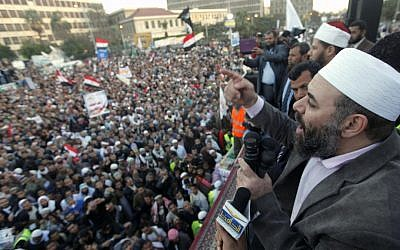 Tarek el-Zomor, a founding member of al-Gamaa al-Islamiyya, speaks to thousands of hard-line Islamist demonstrators in Cairo, Egypt, on Friday (photo credit: AP/Amr Nabil)