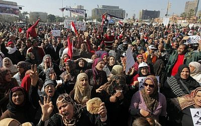 Egyptian protesters shout anti-government slogans and display bread to symbolize the high number of people living in poverty, during a protest in Tahrir Square, in Cairo, Egypt, last month (photo credit: AP/Amr Nabil/File)