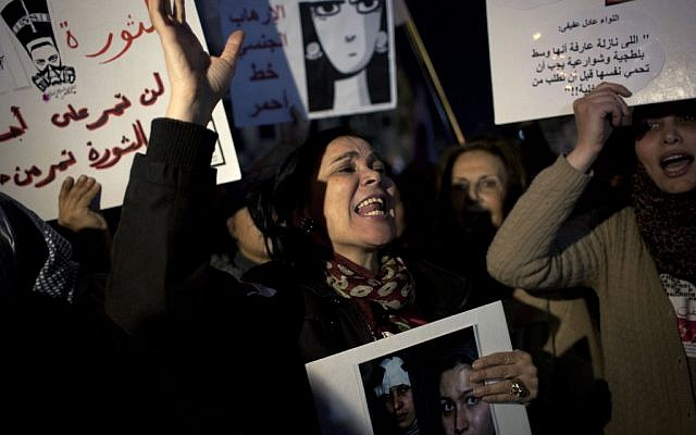 Egyptian woman activists chant slogans while taking part in a protest against sexual harassment and against the Islamist dominated Shura Council blaming women for the attacks against them, in Cairo, Egypt, Tuesday, Feb. 12 (photo credit: AP/Nasser Nasser)