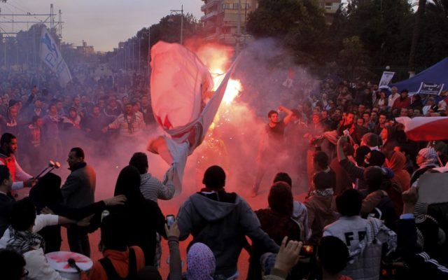 Egyptian protesters shout anti-Mohammed Morsi slogans before clashes in front of the presidential palace in Cairo, Egypt, Friday. (AP Photo/Amr Nabil)