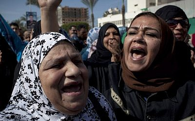 Female protesters chant anti-President Mohammed Morsi slogans in Port Said, Egypt, (photo credit: AP/Nasser Nasser)