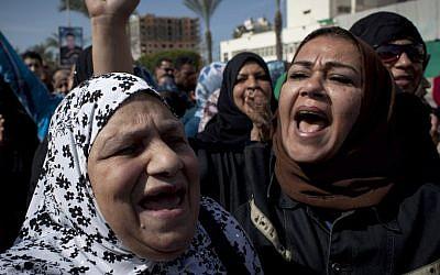 Female protesters chant anti-President Mohammed Morsi slogans in Port Said, Egypt, (photo credit: AP/Nasser Nasser)
