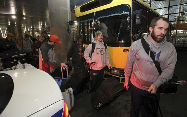 US freestyle wrestling team members arrive at the Imam Khomeini airport in Tehran, Iran, on February 19, 2013, to attend the World Cup tournament. (photo credit: Vahid Salemi/AP)