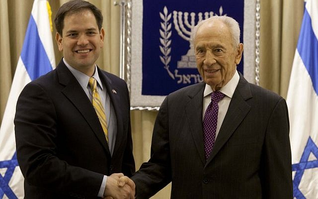 President Shimon Peres, right, shakes hands for photographers with Republican Senator Marco Rubio during their meeting in Jerusalem in February, 2013 (photo credit: AP/Sebastian Scheiner)