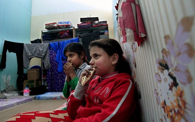 Palestinian children who fled their houses in the Yarmouk camp for Palestinian refugees in south Damascus, sit in a children's library, at the Ein el-Hilweh refugee camp in the southern port city of Sidon, Lebanon, January 15, 2013 (photo credit: Mohammed Zaatari/AP)