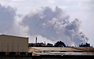 Smoke rises from the Aleppo International Airport earlier this month (photo credit: AP/Aleppo Media Center AMC)