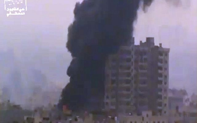 Smoke and fire billow from an explosion in Damascus, Syria, on Feb. 6, 2013 (photo credit: AP/Ugarit News via AP video)