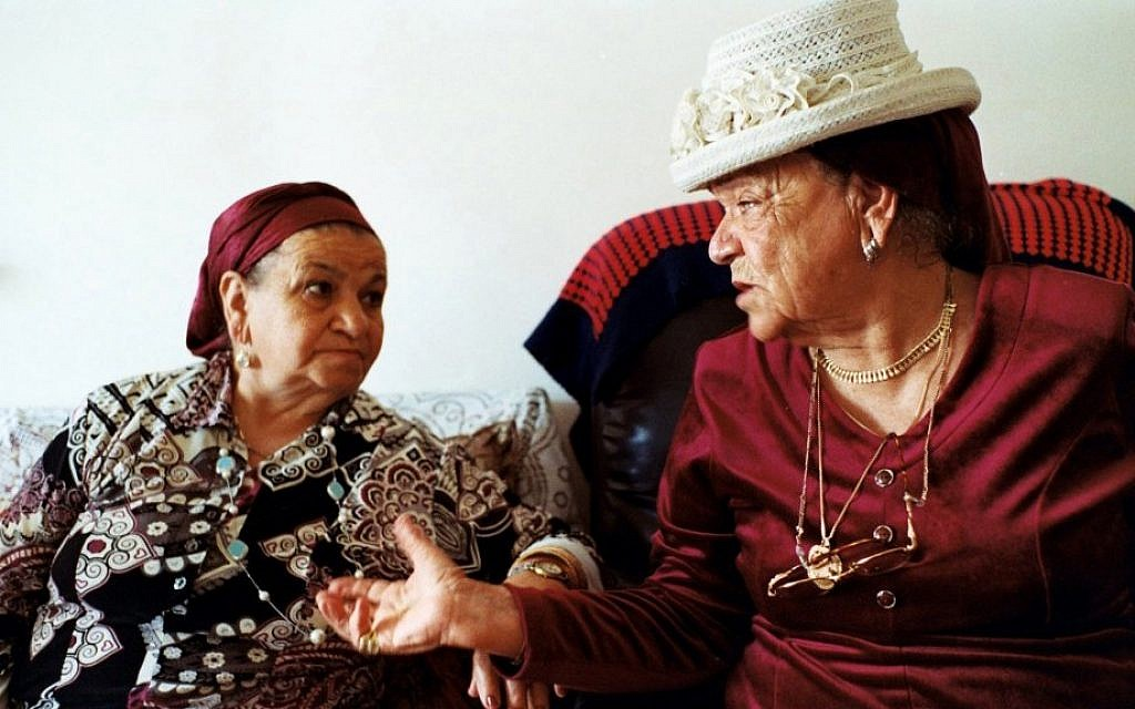 A still from 'Tinghir-Jerusalem: Echoes from the Mellah' shows Aicha Elkoubi, left, and Hannah Schmouyane, Moroccan Jews who immigrated to Israel, reminisce about the old days. (photo credit: AP Photo/Les Films d'un Jour)