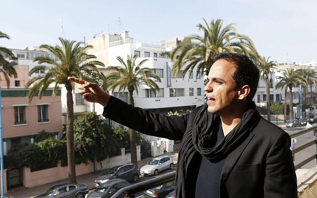Kamal Hachkar, director of the documentary 'Tinghir to Jerusalem' gestures from a balcony in Casablanca, Morocco, on Friday, February 15, 2013. (photo credit: AP Photo/Abdeljalil Bounhar)