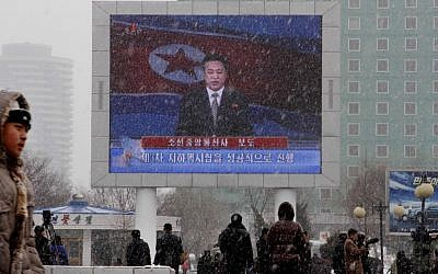 On a large television screen in front of Pyongyang's railway station, a North Korean state television broadcaster announces the news that North Korea conducted a nuclear test on Tuesday, Feb. 12, 2013. (photo credit: AP/Kim Kwang Hyon)