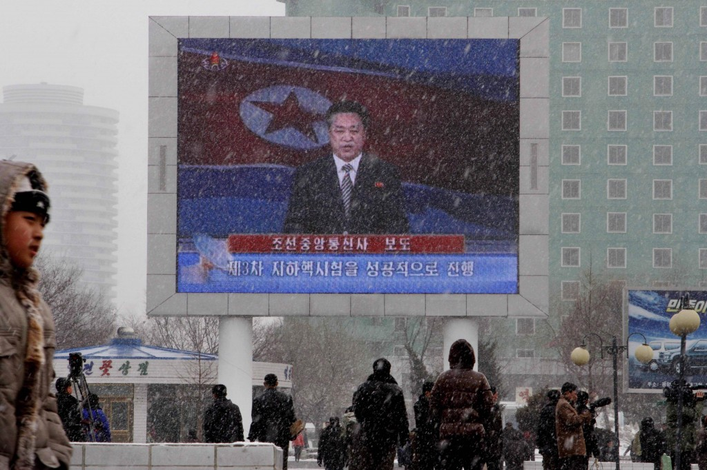 On a large television screen in front of Pyongyang's railway station, a North Korean state television broadcaster announces the news that North Korea conducted a nuclear test on Tuesday. (Photo credit: AP/Kim Kwang Hyon)