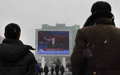 On a large television screen in front of Pyongyang's railway station, a North Korean state television broadcaster announces the news that North Korea conducted a nuclear test on Tuesday, Feb. 12, 2013 (photo credit: AP/Jon Chol Jin)