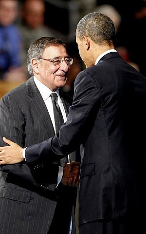 US President Barack Obama embraces outgoing Defense Secretary Leon Panetta during an Armed Forces Farewell Ceremony to honor Panetta, Friday at Joint Base Myer-Henderson Hall in Arlington, Va. (photo credit: AP Photo/Ann Heisenfelt)