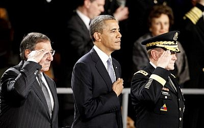 US President Barack Obama attends an Armed Forces Farewell Ceremony to honor outgoing Defense Secretary Leon Panetta, left, in February 2013, at Joint Base Myer-Henderson Hall in Arlington, Va. Joint Chiefs Chairman Army Gen. Martin Dempsey is at right. (photo credit: AP Photo/Ann Heisenfelt)