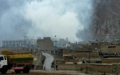 Smoke rises from the site of a bomb blast in a market in Quetta, Pakistan on Saturday, Feb. 16, 2013 (photo credit: AP/Arshad Butt)