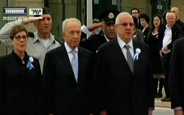 President Shimon Peres (center) and outgoing Knesset speaker Reuven Rivlin (right) at the Knesset swearing-in ceremony in Jerusalem, February 5, 2013. (photo credit: screenshot/Channel 2)