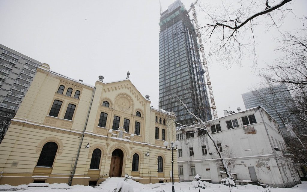 """The headquarters of Warsaw's Jewish community, right, known as the """"white building,"""" could be torn down to make way for a taller, modern building. (Czarek Sokolowski/AP)"""